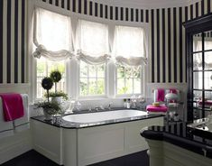 To complement the black-and-white master bedroom, the walls of the master bath were painted in bold black-and-white stripes.