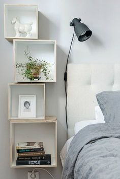 Box shelves as bedside tables for small spaces