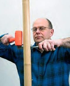 Splitting tonkin cane with a bench chisel