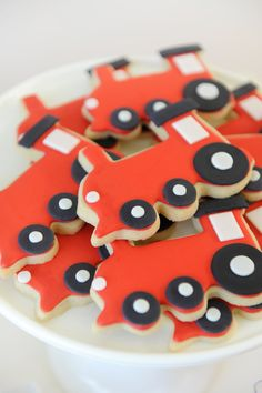Red, white, and black cookies shaped as trains to serve at a train themed children's birthday party. Choo Choo Party styling by Happy Wish Company. Photography by Tammy Hughes Photography. Stationery by Minted artist, Sandra Picco Design.