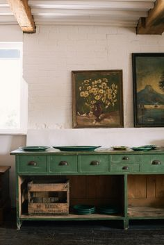 green home accessories kitchen with vintage floral paintings and rustic green sideboard with drawers and open shelving designed by devol kitchens. Green Furniture, Painted Furniture, Shelving Design, Open Shelving, Home Interior, Interior Design, Interior Plants, Vintage Sideboard, Kitchen Sideboard