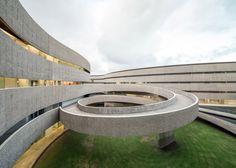 Corduroy-textured concrete wrap GPY Arquitectos' art school in Tenerife