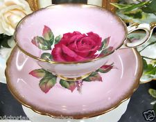 PINK PARAGON TEA CUP AND SAUCER W/RED ROSE CENTRE