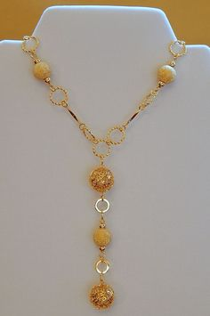 Necklace includes delicate filigree balls and shining rounds with stardust finish, twisted paddle links and braided circles. Gold Bangles Design, Gold Earrings Designs, Gold Jewellery Design, Necklace Designs, Gold Jewelry Simple, Golden Jewelry, Womens Jewelry Rings, Bridal Jewelry, Jewelry Sets