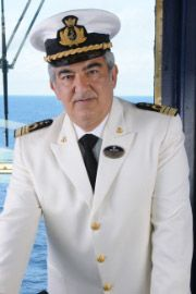 "Typical photo of a cruise ship officer, similar to Captain Covingdale aboard ""The Majesty - Into the Fog""."