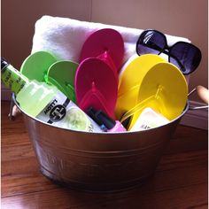 Summer gift basket. Towel, flip flops , sunscreen, sunglasses, nail polish, and margarita mix. could change a lil for kids...