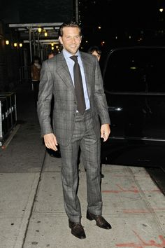 Bradley Cooper wearing a Tom Ford  suit. Beautiful combination of grey suit, blue shirt, and brown shoes.