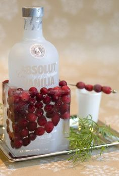 Fabulous for holiday party Save and clean a square milk or orange-juice carton and cut the top off. Put your favorite bottle of vodka inside. Add fresh cranberries and fill halfway with water. Freeze for at least four hours. When you're ready to serve just peel off the milk carton and set your icy drink on a tray to catch the drips..