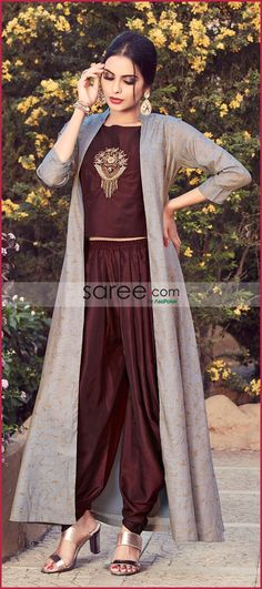 Brown Muslin Silk Indo Western Dhoti Suit with Long JacketYou can find Western dresses and more on our website.Brown Muslin Silk Indo Western Dhoti Suit with Long Jacket Indian Western Dress, Robes Western, Dress Indian Style, Western Gown, Indo Western Dress For Girls, Indo Western Kurti, Indian Fashion Dresses, Indian Designer Outfits, Designer Dresses