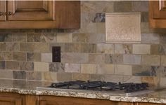 Nice neutral tiles. http://www.kitchentrend.net/wp-content/uploads/2012/03/photos-of-kitchen-countertops-and-backsplashes.jpg