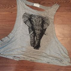 Elephant tank Elephant tank. Open back with ripped cutouts. Very open and flowy top. I bought this from another person on Poshmark and it is too big on me. The size tag is very worn. When I bought this, it was listed as a medium but in my opinion, it runs big because of the openness. Tops