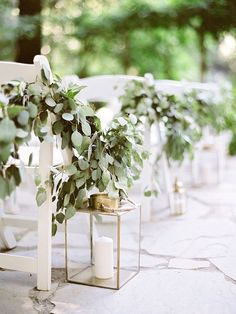 greenery accented wedding ceremony chairs via coco tran / http://www.deerpearlflowers.com/greenery-eucalyptus-wedding-decor-ideas/2/