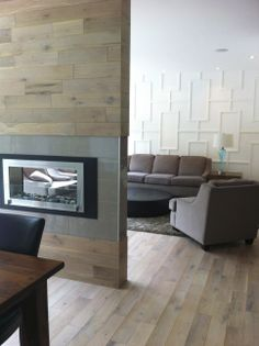 Large plank tile that looks like hardwood on a  fireplace feature wall.
