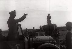 Field Marshal Rommel at dusk leading from the front in the Libyan desert.