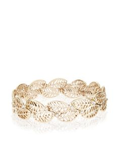 Go back to nature with our gold-tone metal filigree leaf stretch bracelet, accented with small crystal gems for delicate sparkle.
