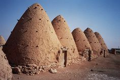 "Treehugger writes about Syrian Beehive houses that are "".Designed for the desert climate, the beehive homes keep the heat out in a few. Organic Architecture, Amazing Architecture, Vernacular Architecture, Classical Architecture, Mud House, Dome House, Igloo House, Old Mansions, Art Africain"