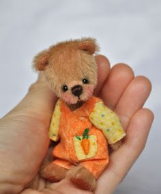 What a sweet face - love the teeny bears!