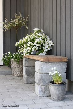Tumbled cement blocks with wood board for quick DIY garden bench