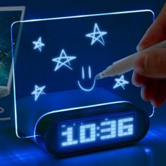Glowing Memo Alarm Clock. excellent for writing down those brilliant ideas you have as you are about to fall asleep