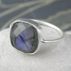 A beautiful, simple, square cut, faceted Labradorite stone set in solid, brushed Sterling Silver. Unique & stunning