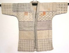 Infant's kimono Cotton, red silk embroidery thread Sashiko and chain stitch embroidery A variety of traditional designsAmong the designs included are the auspicious seven treasures lozenge, the hemp leaf, lightning, waves, braided fences, and other traditional patterns. Three designs that appear to be crests on the chest and back are actually talismans