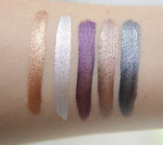 Swatches Rimmel Scandaleyes Liquid Eyeshadow - L-R: Golden Bronze, Mercury Silver, Manganese Purple, Rich Russet, Slate Grey