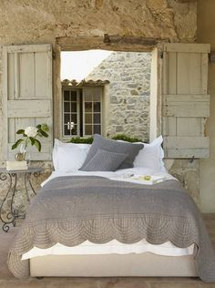 So love this bedroom...stone wall, shutters, bed looks comfy....sigh | Inspired Deco via Woodley Lane #bedroom #stonewalls #woodenshutters