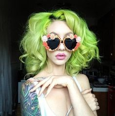 Lime green hair.... this will happen before September