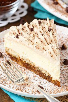 Tiramisu Cheesecake! Layers of ladyfingers, mascarpone filling and Kahlua whipped cream!
