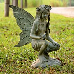 Add a touch of whimsy to your garden or foyer with this lovely statue. An intricately-detailed fairy holds out a small bird, crouching on a rock in a moment ...