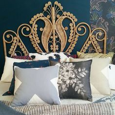 Talk about cushion envy! A cluster of Pony Rider cushions against our Natural Peacock Bed Head.