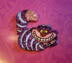 Cheshire Cat Bow Center Glittered Hand painted polymer by moquerie, $7.00