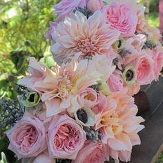inspirational bouquet blush colored dahlias with medium pink roses. replace anemones with medium pink small dahlias, add tips for bells of ireland for green color and dried scabosia pods for filler.