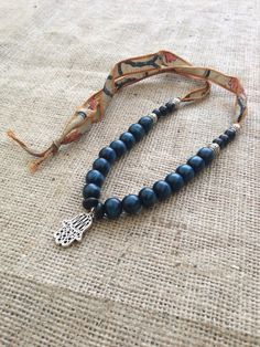 Long Bohemian Silk Necklace with Silver Hamsa Hand by gypsykicks