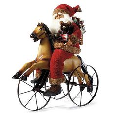 This charming Rocking Horse Santa by Karen Didion will have everyone waxing nostalgic for Christmases of yesteryear. Suited in soft fleece and faux fur, Santa carries a teddy bear, drum and a load of old-fashioned toys in his woven backpack. His preferred method of delivery, a hand-painted rocking horse, is fitted with working metal wheels.