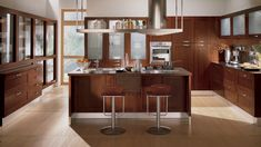 Contemporary Kitchen in Sarasota - silver cabinet hardware, long kitchen island Kitchen With Long Island, Long Kitchen, Kitchen Island, Walnut Cabinets, Wood Cabinets, Kitchen Cabinets, Kitchen Cabinet Colors, Kitchen Colors, Kitchen Stuff