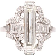 Platinum Diamond Art Deco ring ❤ liked on Polyvore featuring jewelry, rings, art deco diamond ring, diamond rings, round ring, emerald cut cocktail ring and art deco jewelry