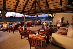 Overlooking the legendary Chiefs Island and bordering the Moremi Game Reserve, Gunn's Camp is one of the last few remaining luxury, vintage safari camps. Vintage Safari, Outdoor Tables, Outdoor Decor, Sight & Sound, Game Reserve, Lounge Areas, Camps, Relax, Patio