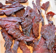 Teriyaki Beef Jerky Recipe London Broil or Carne Asada Thinly Sliced Cup Soy Sauce Cup Mirin 2 tbs Sugar 3 Coins Fresh Cut Ginger tsp Onion Powder 1 Clove crushed Garlic tsp Black Pepper Mix ingredients together and marinate for 24 hr Jerky Recipes, Grilling Recipes, Meat Recipes, Game Recipes, Recipies, Simple Beef Jerky Recipe, Teriyaki Beef Jerky, Smoked Beef Jerky, Bacon Jerky