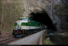 Shortly after being released from the Chattanooga shops in Chattanooga,TN, the SOUTHERN heritage unit 8099 leads an empty hopper train in it's first trek through the Natural Tunnel. A true Southern Railway landmark.