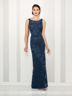 Sleeveless ribbon on tulle slim A-line gown with illusion curved bateau neckline and illusion back, hand-beaded high waistline, slightly flared skirt, Matching shawl included.NEW Colors: Navy Blue and Petal Sizes: 4 – 20 Colors: Navy Blue, Silver, Petal, Jade, Black
