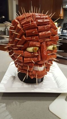 Pepperoni pin head from Hell Raiser for Halloween party food. Could also be made with hot dogs or Vienna sausage.