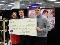 Long time supporter,Santa Rita, presents a check to Cell Phones for Soldiers Founders, Robbie and Brittany Bergquist!