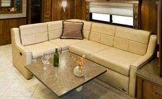 The table can be raised and lowered. Credit: Fleetwood RV Inc