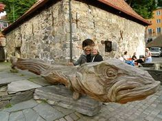 Admiring the big fish in Bergen, Norway. The fish was made with an electric saw!!