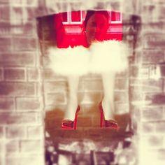 Louboutin window display. Santa stuck in the chimney