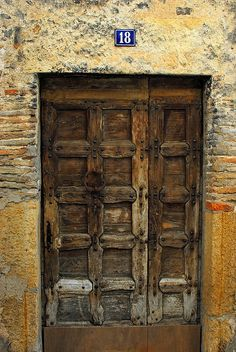 I love old doors. I want to frame a bunch of pictures of old doors all over a wall in my house. This one's from France.