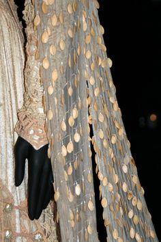 Wedding train with hundreds of hand-sewn pumpkin seeds for 1967 movie Camelot. Worn by Vanessa Redgrave as Guinevere.