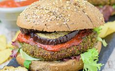 Quinoa, spinach, and bread crumbs come together in patty form for these quinoa burgers. They're very easy to make, and only require you to cook the ingredients and then mash them into patty form before baking or lightly frying them.