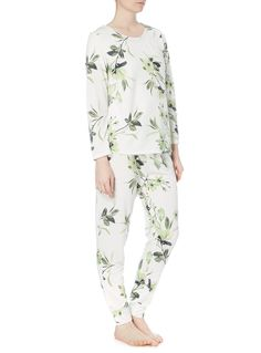 Introduce fresh prints into your nightwear collection with this floral leaf design tee. With optional matching bottoms and button tabs for rolled sleeves, this pyjama top offers a range of versatile looks.  Multicoloured floral long sleeve pyjama top Floral leaf print Button back sleeve Loopback fabric Model's height is 5'11